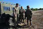 """(L-r) Danish Master Sergeant Daniel De Giorgi and Captain Ulrik Sorensen of the Danish First Armored Battalion with an unidentified American soldier during a tank maneuver training exercise where Americans and Danes worked together to simulate battle against opposing forces at the Drawsko Pomorskie Training Area in Poland on June 11, 2015.   NATO is engaged in a multilateral training exercise """"Saber Strike,"""" the first time Poland has hosted such war games, involving the militaries of Canada, Denmark, Germany, Poland, and the United States."""
