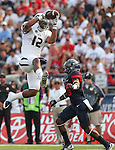 Nevada's Hasaan Henderson (12) makes a reception against Arizona's DaVonte' Neal (19) during the first half of an NCAA college football game in Reno, Nev. on Saturday, Sept. 12, 2015. (AP Photo/Cathleen Allison)