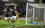 John Souttar celebrates his goal for Dundee Utd with Motherwell keeper Dan Twardzik lying in the nets distraught