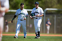 Dartmouth Big Green Justin Fowler (25) talks with first base coach Andy Revell (7) during a game against the Villanova Wildcats on March 3, 2018 at North Charlotte Regional Park in Port Charlotte, Florida.  Dartmouth defeated Villanova 12-7.  (Mike Janes/Four Seam Images)