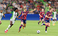AUSTIN, TX - JUNE 16: Ijeoma Esther Okoronkwo #12 of Nigeria pulls the jersey of Kristie Mewis #22 of the United States in an attempt to keep her from the ball during a game between Nigeria and USWNT at Q2 Stadium on June 16, 2021 in Austin, Texas.