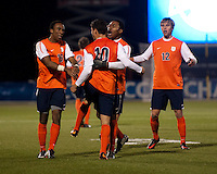 Nicko Corriveau (10) of Virginia celebrates his goal with teammate Darius Madison (9) during the ACC tournament semifinals at the Maryland SoccerPlex in Boyds, MD.  Virginia advanced to the finals after tying Notre Dame, 3-3, in overtime and then defeating them on penalty kicks.
