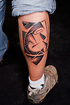 German man with abstract, nonfigurativ, tattoo on lower right leg.<br /> From the Kolding Tattoo Convention, Denmark