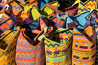 Colorful artwork closeupof handmade bags in shopping center on market day in village of Chichicastenango Guatemal