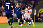 Doan Ritsu of Japan (C) fights for the ball with Milad Mohammadikeshmarzi of Iran (R) during the AFC Asian Cup UAE 2019 Semi Finals match between I.R. Iran (IRN) and Japan (JPN) at Hazza Bin Zayed Stadium  on 28 January 2019 in Al Alin, United Arab Emirates. Photo by Marcio Rodrigo Machado / Power Sport Images