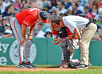 10 June 2012: Washington Nationals catcher Jesus Flores is checked out by Head Athletic Trainer Lee Kuntz and Manager Davey Johnson during action against the Boston Red Sox at Fenway Park in Boston, MA. The Nationals defeated the Red Sox 4-3 to sweep their 3-game interleague series. Mandatory Credit: Ed Wolfstein Photo