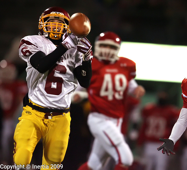 SIOUX FALLS, SD - OCTOBER 22:  Justin Warne #6 of Roosevelt has the ball bounce off his fingertips in front of Sam Shelton #49 of Lincoln for an incomplete pass in the second quarter of their game Thursday night at Howard Wood Field. (Photo by Dave Eggen/Inertia).