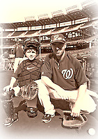16 May 2012: Washington Nationals first baseman Adam LaRoche's son Drake LaRoche poses with his Dad during batting practice prior to a game against the Pittsburgh Pirates at Nationals Park in Washington, DC. Adam notched his 1000th career hit and was named Player of the Game as the Nationals defeated the Pirates 7-4 in the first game of their 2-game series. Mandatory Credit: Ed Wolfstein Photo
