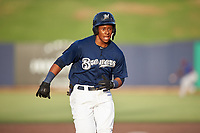 AZL Brewers Blue Orveo Saint (30) hustles towards third base for a triple during an Arizona League game against the AZL Rangers on July 11, 2019 at American Family Fields of Phoenix in Phoenix, Arizona. The AZL Rangers defeated the AZL Brewers Blue 5-2. (Zachary Lucy/Four Seam Images)