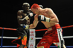 Hari Miles ( Red with Black stripe ) V Nick Okoth (Black flame shorts). Joe Calzaghe Promotions Boxing Evening .Date: Friday 20/11/2009,  .© Ian Cook IJC Photography, 07599826381, iancook@ijcphotography.co.uk,  www.ijcphotography.co.uk, .
