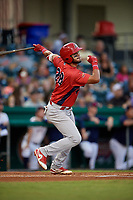 Peoria Chiefs catcher Dennis Ortega (28) follows through on a swing during a game against the Bowling Green Hot Rods on September 15, 2018 at Bowling Green Ballpark in Bowling Green, Kentucky.  Bowling Green defeated Peoria 6-1.  (Mike Janes/Four Seam Images)