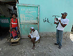 Prelok Pierre Louis (right), a community health worker for Oganizasyon Sante Popil (OSAPO), speaks to residents of Montrouis, Haiti, about steps they can take to prevent the spread of cholera, which appeared on the quake-ravaged Caribbean island nation in late 2010. OSAPO's work is supported by Diakonie Katastrophenhilfe and the Lutheran World Federation, both members of the ACT Alliance. Health workers from OSAPO go out to surrounding neighborhoods and communities in teams of three, providing education, distributing anti-bacterial soap and oral rehydration salts, and referring ill patients to the OSAPO clinic...