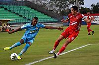 MONTERIA - COLOMBIA, 07-03-2021: Wilder Guisao de Jaguares de Cordoba F.C. y Michael Ordoñez de Patriotas Boyaca F. C. disputan el balón durante partido entre Jaguares F. C. y Patriotas Boyaca F. C. de la fecha 11 por la Liga BetPlay DIMAYOR I 2021, en el estadio Jaraguay de Monteria de la ciudad de Monteria. / Wilder Guisao of Jaguares de Cordoba F.C. and Michael Ordoñez of Patriotas Boyaca F. C. vie for the ball during a match between Jaguares F. C. and Patriotas Boyaca F. C., of the 11th date for the Betplay DIMAYOR I 2021 League at Jaraguay de Monteria Stadium in Monteria city. Photo: VizzorImage / Andres Lopez / Cont.