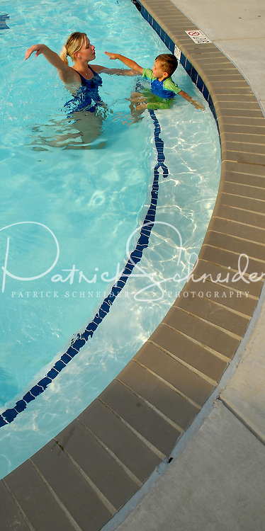 A child takes swim lessons at Berewick master-planned community in southwest Mecklenburg County, Charlotte, NC. The property is developed by Pappas Properties.