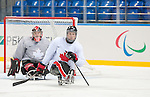 Sochi, RUSSIA - Mar 2 2014 -  Corbin Watson and Dominic Larocque during practice before the 2014 Paralympics in Sochi, Russia.  (Photo: Matthew Murnaghan/Canadian Paralympic Committee)