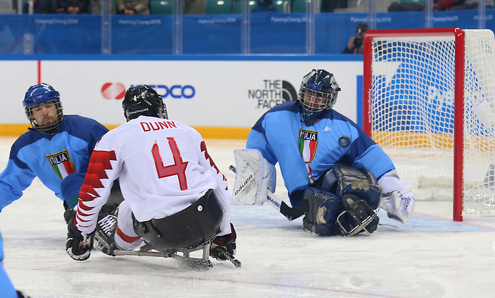 Pyeongchang, Korea, 11/3/2018-James Dunn of Canada plays Italy in hockey during the 2018 Paralympic Games in PyeongChang. Photo Scott Grant/Canadian Paralympic Committee.
