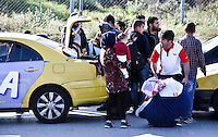 Pictured: Refugees arrive to the camp Friday 26 February 2016<br /> Re: Hundreds of refugees have been given temporary shelter at the Stefanakis Army Camp in the Schisto area of Athens, Greece.