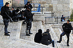 Israeli policemen check the IDs of Palestinian youths in front of Damascus gate, in Jerusalem's old city on Dec. 31, 2015. The Commission of Prisoners' Affairs (CPA) said that at least 6,830 Palestinians were detained by Israeli troops in the occupied Palestinian Territory since the beginning of the year 2015, marking the highest rate of daily arrests in five years, and 3285 Palestinians were detained in the past three months alone since the beginning of violent unrest in early Octobe. Photo by Mahfouz Abu Turk