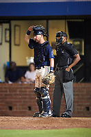 Mobile BayBears catcher Michael Barash (16) in front of home plate umpire Edwin Moscoso during a game against the Chattanooga Lookouts on May 5, 2018 at Hank Aaron Stadium in Mobile, Alabama.  Chattanooga defeated Mobile 11-5.  (Mike Janes/Four Seam Images)
