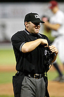 Home plate umpire Tyler Curlis during a game between the Batavia Muckdogs and Mahoning Valley Scrappers at Dwyer Stadium on August 22, 2011 in Batavia, New York.  Mahoning Valley defeated Batavia 11-3.  (Mike Janes/Four Seam Images)
