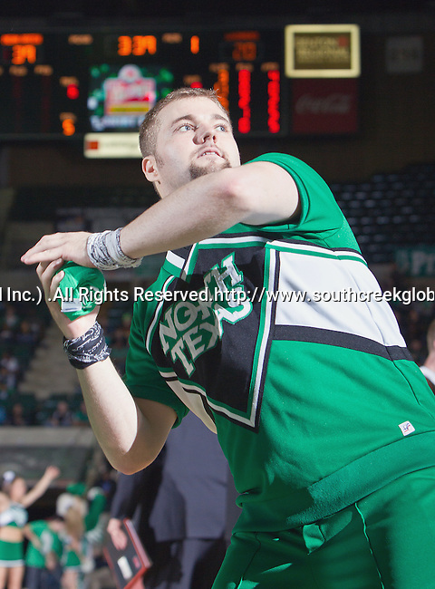 North Texas Mean Green cheerleaders in action during the game between the Louisiana Monroe Warhawks and the University of North Texas Mean Green at the North Texas Coliseum,the Super Pit, in Denton, Texas. UNT defeats ULM 86 to 51..
