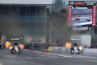 Mar. 11, 2012; Gainesville, FL, USA; NHRA top fuel dragster driver Tony Schumacher (left) defeats Antron Brown during the Gatornationals at Auto Plus Raceway at Gainesville. Mandatory Credit: Mark J. Rebilas-