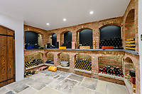 BNPS.co.uk (01202) 558833. <br /> Pic: TailorMade/BNPS<br /> <br /> Pictured: Wine cellar. <br /> <br /> A multi-millionaire is hoping to have a shot at selling his luxury mansion - by throwing a hi-tech golf simulator into the deal.<br />  <br /> Golf-loving Barry Bester put the waterfront property on Sandbanks, Dorset, on the market for £11m last year.<br />  <br /> He is now offering his £40,000 state-of-the-art simulator he has had built on the grounds with the sale.