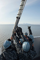 """130506-N-DR144-196 ANCHORAGE, Alaska (May 6, 2013)- Deck department Sailors take down the jack staff as San Antonio-class amphibious transport dock ship USS Anchorage (LPD 23) passes Mt. Susitna, known locally as """"Sleeping Lady,"""" while leaving the Port of Anchorage. Anchorage departed its namesake city of Anchorage, Alaska after a five-day port visit for the ship's commissioning. (U.S. Navy photo by Mass Communication Specialist 1st Class James R. Evans / RELEASED)"""