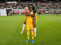 AUSTIN, TX - JUNE 16: Jane Campbell #18 of the USWNT poses for a photo with Michelle Alozie #22 of Nigeria during a game between Nigeria and USWNT at Q2 Stadium on June 16, 2021 in Austin, Texas.