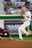 LSU Tigers second baseman JaCoby Jones #23 looks towards the umpire after tagging out a Mississippi State base stealer during the NCAA baseball game on March 16, 2012 at Alex Box Stadium in Baton Rouge, Louisiana. LSU defeated Mississippi State 3-2 in 10 innings. (Andrew Woolley / Four Seam Images).
