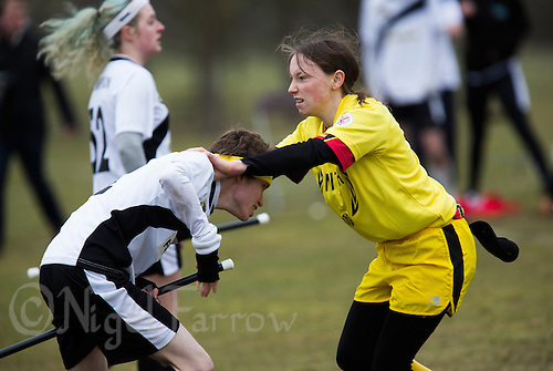 08 MAR 2015 - NOTTINGHAM, GBR - Snitch runner Nicole Stone (right) attempts to prevent Jimmy Boyd, a Leicester Thestrals' seeker, from seizing the snitch, a tennis ball in a black sock hanging from the back of her shorts, during the 2015 British Quidditch Cup at Woollaton Hall and Deer Park in Nottingham, Great Britain (PHOTO COPYRIGHT © 2015 NIGEL FARROW, ALL RIGHTS RESERVED)