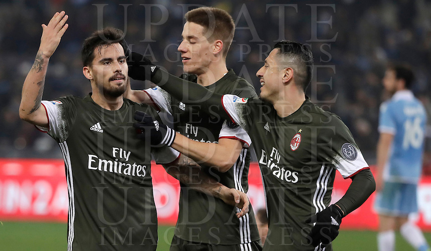 Calcio, Serie A: Lazio, Stadio Olimpico, 13 febbraio 2017.<br /> Milan's Fernandez Suso (l) celebrates after scoring  with teammates Mario Pasalic (c) and Gianluca Lapadula (r)   during the Italian Serie A football match between Lazio and Milan at Roma's Olympic Stadium, on February 13, 2017.<br /> UPDATE IMAGES PRESS/Isabella Bonotto