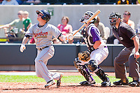 Tyler Holt #1 of the Kinston Indians follows through on his swing against the Winston-Salem Dash at BB&T Ballpark on April 17, 2011 in Winston-Salem, North Carolina.   Photo by Brian Westerholt / Four Seam Images