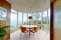 BNPS.co.uk (01202) 558833. <br /> Pic: Albury&Hall/BNPS<br /> <br /> Pictured: The dining room makes the most of the view. <br /> <br /> A unique 'grand design' cliff-top home that has dramatic sea views has gone on the market for £2m.<br /> <br /> The three storey six-bedroom property was designed in the 1960s by architect John Morgan for him to live in.<br /> <br /> At the time the flat-roofed building with floor to ceiling windows was considered a revolutionary design.<br /> <br /> The property's stunning location on the cliffs above Swanage in Dorset provide uninterrupted sea views of Poole Bay and across to The Needles on the Isle of Wight.