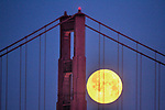 The full moon with the Golden Gate Bridge seen from St. Francis Yacht Club, San Francisco, CA.