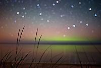 magic summer nights- aurora and bokeh stars over Lake Superior