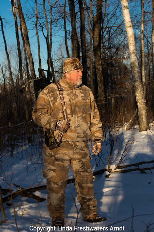 Crossbow hunter in late afternoon