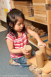 Education Preschool 3 year old girl building with wooden blocks