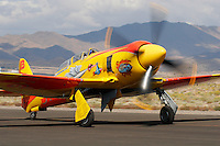 """Mike Brown's colorful Hawker built Sea Fury """"September Pops"""" is taxied along the ramp at Stead Field, Nevada. The British built aircraft was originally delivered to the German Air Force in 1959 and was brought to the United States in 1985. It was re-built in 1997 and has raced at the Reno Air Races regularly since then. Photographed 09/07"""