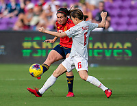 ORLANDO, FL - MARCH 05: Mariona Caldentey #8 of Spain crosses the ball away from Hina Sugita #6 of Japan during a game between Spain and Japan at Exploria Stadium on March 05, 2020 in Orlando, Florida.