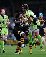 James Wilson of Northampton Saints secures the high ball as Ashley Johnson of Wasps challenges during the Premiership Rugby Round 2 match between Wasps and Northampton Saints at Adams Park on Sunday 14th September 2014 (Photo by Rob Munro)