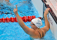July 28, 2012: Melanie Schlanger of Australia reacts after winning the  women's 4x100 meter freestyle relay final by setting a new Olympic record at the Aquatics Center on day one of 2012 Olympic Games in London, United Kingdom.