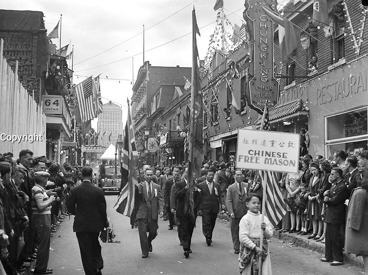 FILE PHOTO - Montreal's Chinese community celebrates V-J Day and the official surrender of Japan with a parade in Chinatown, September 2, 1945.<br /> <br /> PHOTO : Conrad Poirier