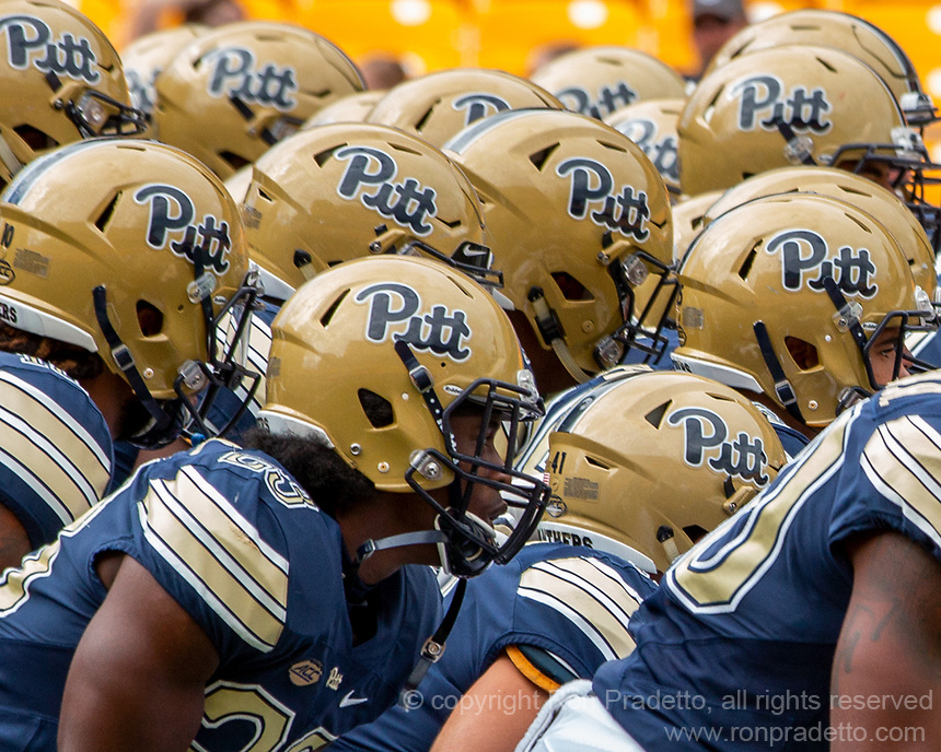 As Pitt takes the field a cluster of Pitt helmets forms. The Pitt Panthers football team defeated the Georgia Tech Yellow Jackets 24-19 on September 15, 2018 at Heinz Field in Pittsburgh, Pennsylvania.