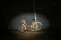 CHINA. Beijing. A bicycle standing against a fence. 2008