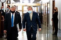 "United States Senator Dick Durbin (Democrat of Illinois), left, and US Senator Lindsey Graham (Republican of South  Carolina), Chairman, US Senate Judiciary Committee, right, walk to a US Senate Judiciary Committee Hearing ""to examine COVID-19 fraud, focusing on law enforcement's response to those exploiting the pandemic"" on Capitol Hill in Washington, DC on June 9, 2020.<br /> Credit: Erin Schaff / Pool via CNP/AdMedia"