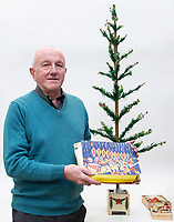 "PLEASE BYLINE Hansons Auctioneers Ltd/Athena Pictures<br /> Pictured: Steve Rose with his Christmas tree and decorations<br /> Re: One of the first mass-produced Christmas trees will be sold at auction after owned by the same family for 80 years.<br /> The parents of Steve Rose, 74, used to decorate the vintage 1937 tree which they bought from Woolworths, every year in their home in Markham, Caerphilly and kept on with the tradition after they died.<br /> But Mr Rose feels it is time to say goodbye and give someone else the chance to create a simple, vintage Christmas.<br /> The tree is offered for sale alongside Mr Rose's lights and baubles and has an estimate of £200-300, but a similar item sold last year without any decorations for £420.<br /> Mr Rose, a retired Biology teacher, the only son of a miner, is parting with his heirlooms because he has no children to leave them to.<br /> ""It was our main family tree for years and I remember my mum putting it up every Christmas,"" he said.<br /> ""Christmas was not an extravagant affair... in the late 1940s you'd get a Christmas sock and inside it was a tangerine, nuts, some loose change and small presents."
