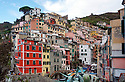 The city of Riomaggiore in Cinque Terra, Italy.  The five cities are all very colorful and positioned on the water  There are hiking trails connecting the five cities, or you can visit most of them by boat.