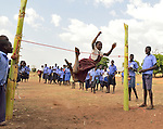In northern Uganda, children play safely in their school yards.  The region is peaceful after years of protracted, brutal insurgency by the Lords Resistance Army (LRA).  During that period children were routinely abducted from schools and their homes, and forced to become child soldiers in the LRA.  Families were forced to live in armed government camps for safety.  Today,  the resettlement process is ongoing. with ongoing efforts to encourage remaining child soldiers back from jungle camps across the border.