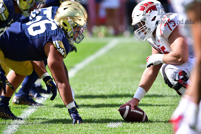 September 25, 2021; Defensive lineman Howard Cross III (56) readies for the snap against Wisconsin during the Shamrock Series game at Soldier Field in Chicago. (photo by Matt Cashore)